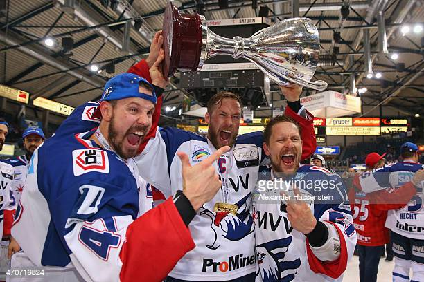 Christoph Ullmann of Mannheim celebrates with his team mates Marcus Kink and Ronny Arendt winning the German Championship title after winning the DEL...