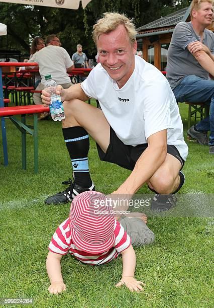 Christoph von Friedl and his baby son Jonathan during the charity football game 'Kick for Kids' to benefit 'Die Seilschaft zusammen sind wir stark...