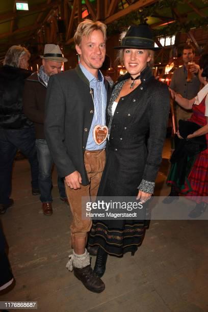 """Christoph von Friedl and his wife Eva-Maria Grein von Friedl pose during the """"Fernsehen mit Herz"""" Wiesn event during the Oktoberfest 2019 at Kufflers..."""