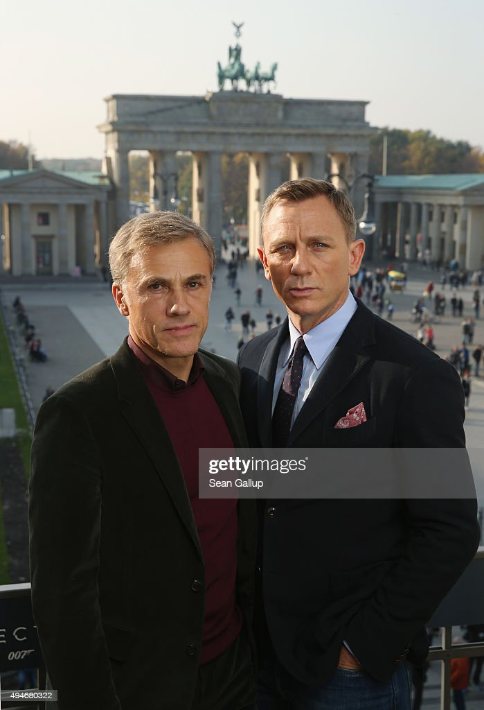Christoph Waltz and Daniel Craig pose with the Brandenburg Gate behind during a photocall prior the German premiere of the new James Bond movie 'Spectre' at Hotel Adlon on October 28, 2015 in Berlin, Germany.