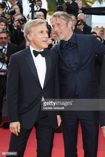 Christoph Waltz and Mads Mikkelsen attends the 70th Anniversary screening during the 70th annual Cannes Film Festival at Palais des Festivals on May...