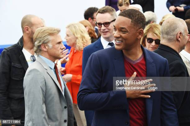 Christoph Waltz and Will Smith attend the 70th Anniversary photocall during the 70th annual Cannes Film Festival at Palais des Festivals on May 23...