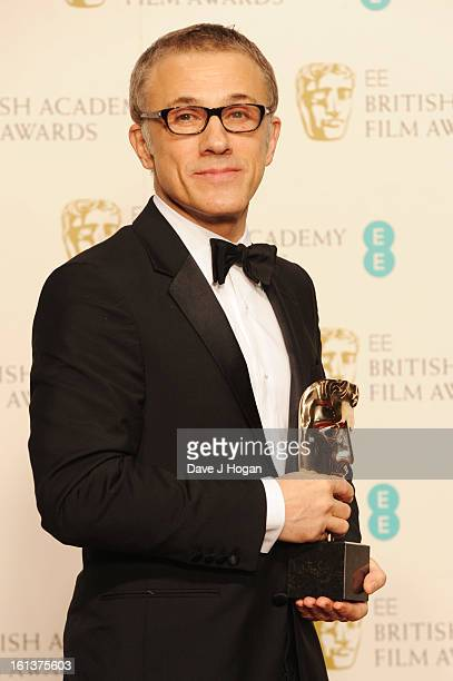Christoph Waltz poses with the Best Supporting Actor Award in the press room at The EE British Academy Film Awards 2013 at The Royal Opera House on...
