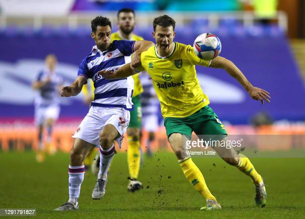 Christoph Zimmermann of Norwich City is tackled by Sam Baldock of Reading FC during the Sky Bet Championship match between Reading and Norwich City...