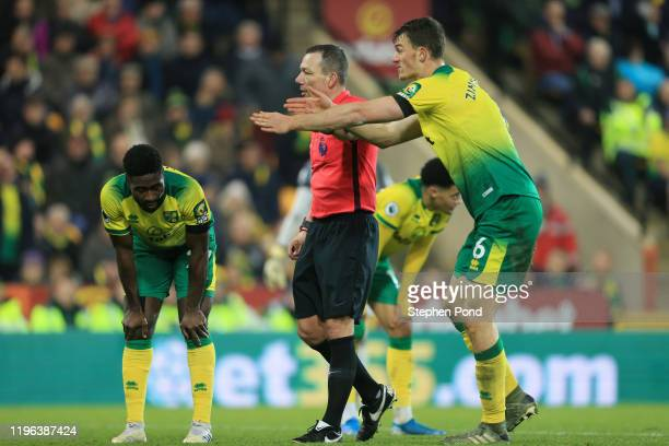 Christoph Zimmermann of Norwich City speaks to referee Kevin Friend during the Premier League match between Norwich City and Tottenham Hotspur at...
