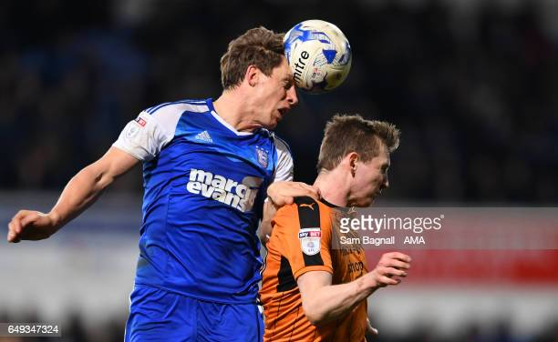 Christophe Berra of Ipswich Town and Jon Dadi Bodvarsson of Wolverhampton Wanderers during the Sky Bet Championship match between Ipswich Town and...