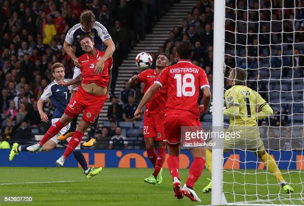 Christophe Berra of Scotland scores the opening goal during the FIFA 2018 World Cup Qualifier between Scotland and Malta at Hampden Park on September...