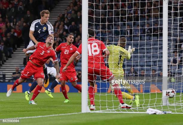 Christophe Berra of Scotland scores their first goal during the FIFA 2018 World Cup Qualifier between Scotland and Malta at Hampden Park on September...