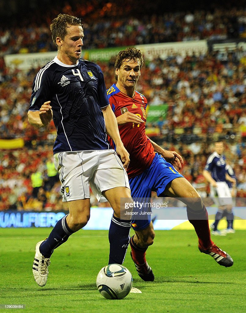 Christophe Berra (L) of Scotland shields Fernando Llorente of Spain from the ball during the UEFA EURO 2012 Group I Qualifier between Spain and Scotland at the Rico Perez stadium on October 11, 2011 in Alicante, Spain.