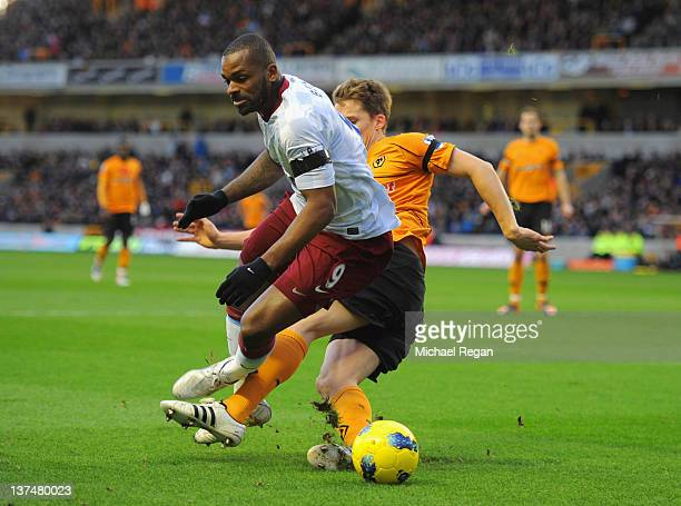Christophe Berra of Wolverhampton fouls Darren Bent of Aston Villa to concede a penalty during the Barclays Premier League match between...