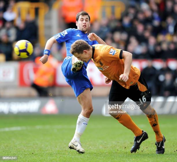 Christophe Berra of Wolverhampton stops the shot from Joe Cole of Chelsea and is kicked in the face during the Barclays Premier League match between...