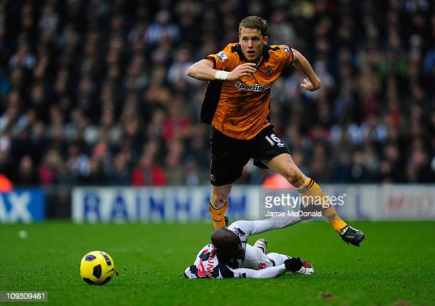 Christophe Berra of Wolverhampton Wanderers slips the tackle of MarcAntoine Fortune of West Bromwich Albion during the Barclays Premier League match...