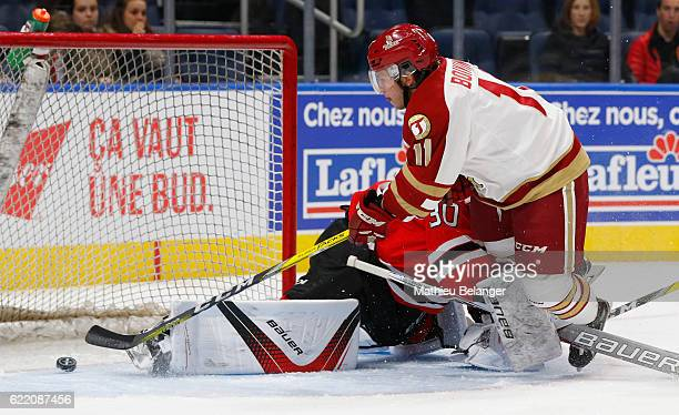 Christophe Boivin of the Acadie-Bathurst Titan scores a goal against the Quebec Remparts during their QMJHL hockey game at the Centre Videotron on...