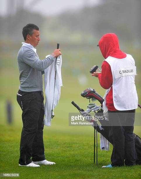 Christophe Brazillier of France wipes his golf club at the 11th hole during Day Two of the Madeira Islands Open Portugal BPI at Club de Golf do Santo...