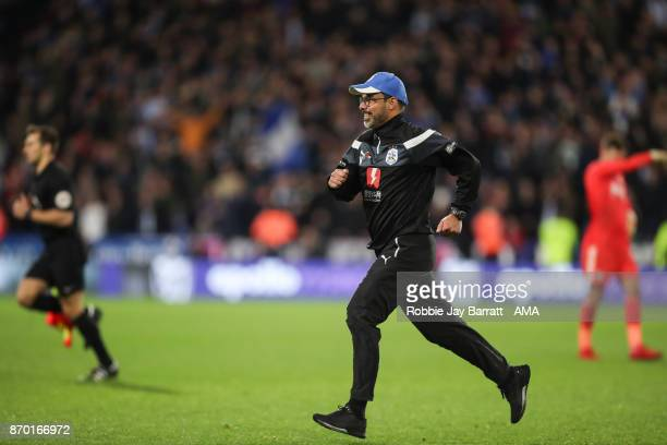 Christophe Buhler assistant head coach of Huddersfield Town celebrates as he runs on to the pitch at full time during the Premier League match...