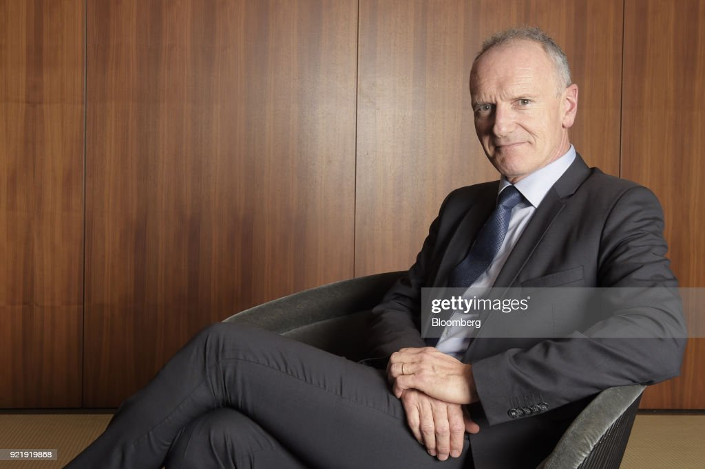 Christophe Cuvillier, chief executive officer of Unibail-Rodamco SE, sits for a photograph in Melbourne, Australia, on Wednesday, Feb. 21, 2018. Cuvillier said shopping malls must evolve to counter the threat of online retailers such as Amazon.com Inc., amid his companys A$21 billion ($17 billion) bid to buy Australias Westfield Corp. Photographer: Carla Gottgens/Bloomberg via Getty Images