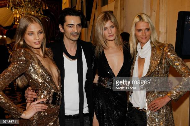 Christophe Decarnin poses with models backstage during the Balmain Ready to Wear show as part of the Paris Womenswear Fashion Week Fall/Winter 2011...