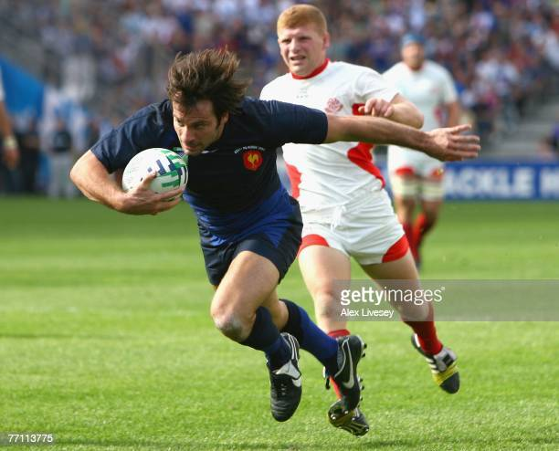 Christophe Dominici of France surges forward to score his team's sixth try during Match Thirty Eight of the Rugby World Cup 2007 between France and...