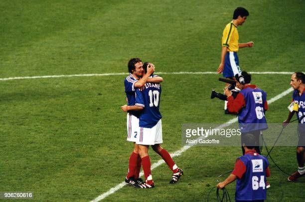 Christophe Dugarry and Zinedine Zidane of France celebrate the victory during the Soccer World Cup Final between Brazil and France on July 12 1998 in...