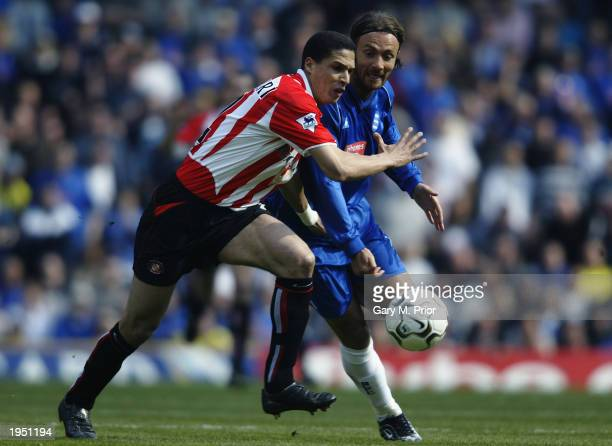 Christophe Dugarry of Birmingham City has his route forward blocked off by Talal El Karkouri of Sunderland during the FA Barclaycard Premiership...
