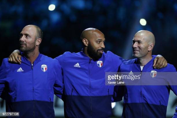 Christophe Dugarry Thierry Henry and Zinedine Zidane of France 98 pose before the Friendly match between France 98 and FIFA 98 at U Arena on June 12...