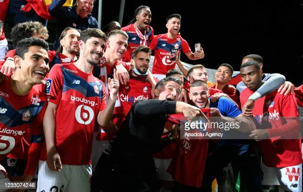 Christophe Galtier , Coach of Lille and players celebrate after winning the French Ligue soccer match between Angers SCO and Lille at Stade Raymond...