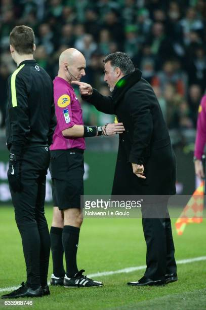 Christophe Galtier coach of Saint Etienne and referee Tony Chapron during the Ligue 1 match between As Saint Etienne and Olympique Lyonnais Lyon at...