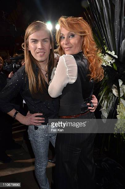 Christophe Guillarme and Julie Pietri attend the Christophe Guillarme Runway - Paris Fashion Week Fall/Winter 2012 at Bal a Jo on March 2, 2011 in...