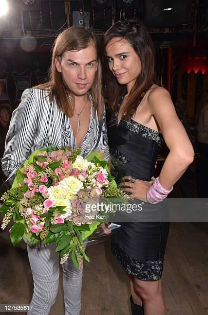 Christophe Guillarme and singer Melissa Mars attend the Christophe Guillarme Front Row Paris Fashion Week Spring / Summer 2012 at Balajo on September...