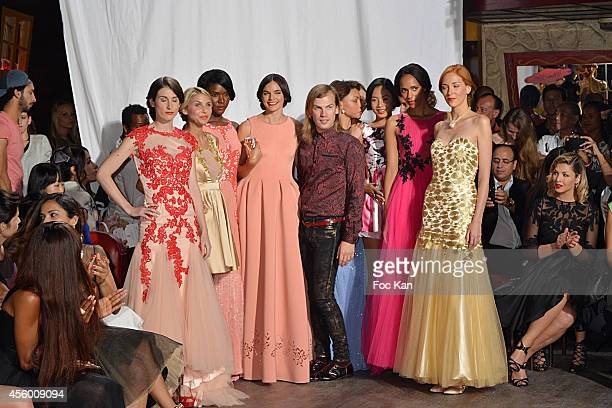 Christophe Guillarme poses with his models during the Finale of Christophe Guillarme show as part of the Paris Fashion Week Womenswear Spring/Summer...