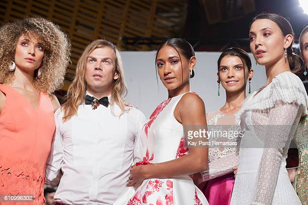 Christophe Guillarme poses with models after the Christophe Guillarme show as part of the Paris Fashion Week Womenswear Spring/Summer 2017 on...