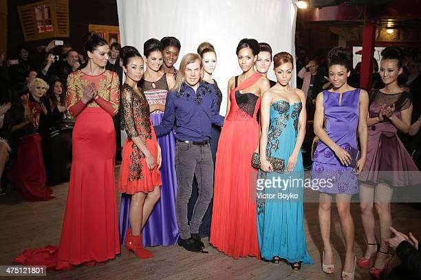 Christophe Guillarme walks the runway during the Christophe Guillarme show as part of the Paris Fashion Week Womenswear Fall/Winter 20142015 on...