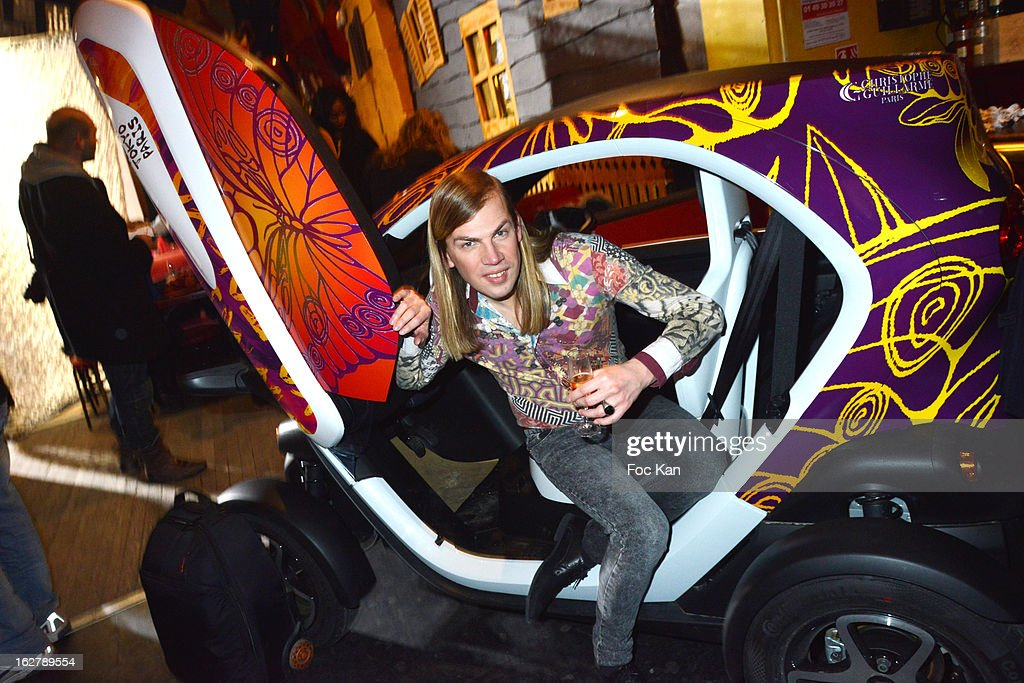 Christophe GuillarmeÊposes in a Twizzy car he designed during the Christophe Guillarme Fall/Winter 2013 Ready-to-Wear show as part of Paris Fashion Week on February 26, 2013 in Paris, France.