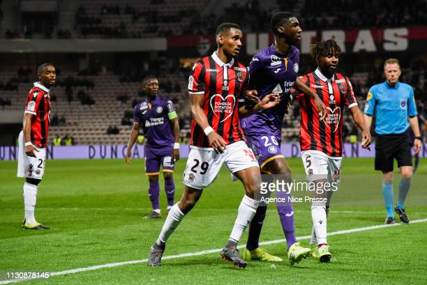 Christophe Herelle and Adrien Tameze of Nice and Kalidou Sidibe of Toulouse during the Ligue 1 match between Nice and Toulouse at Allianz Riviera...