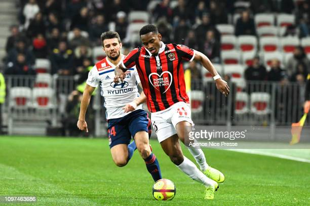 Christophe Herelle of Nice and Leo Dubois of Lyon during the Ligue 1 match between Nice and Lyon at Allianz Riviera on February 10 2019 in Nice France