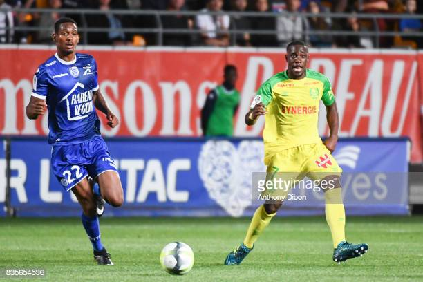 Christophe Herelle of Troyes and Jules Iloki of Nantes during the Ligue 1 match between Troyes Estac and FC Nantes at Stade de l'Aube on August 19...