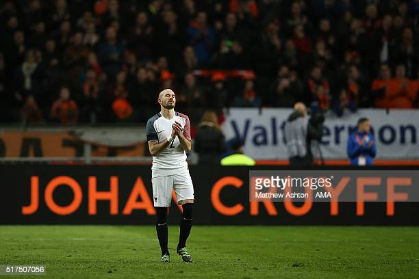 Christophe Jallet of France applauds as the match is stopped after 14 minutes for a minutes applause to acknowledge the late Johan Cruyff who wore...
