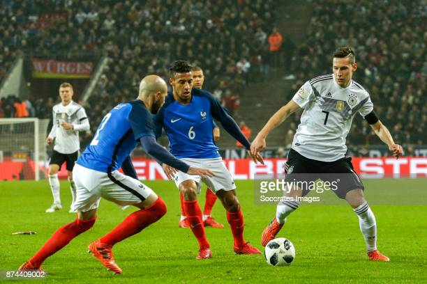 Christophe Jallet of France Corentin Tolisso of France Julian Draxler of Germany during the International Friendly match between Germany v France at...