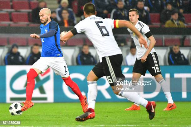 Christophe Jallet of France Sami Khedira of Germany and Julian Draxler of Germany during the international friendly match between Germany and France...