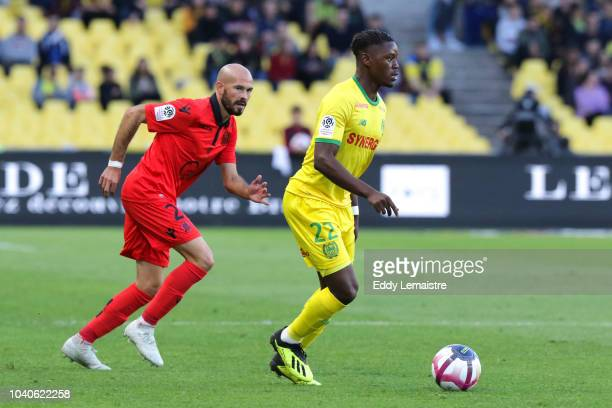 Christophe Jallet of Nice and Anthony Limbombe of Nantes during the Ligue 1 match between Nantes and Nice at Stade de la Beaujoire on September 25...