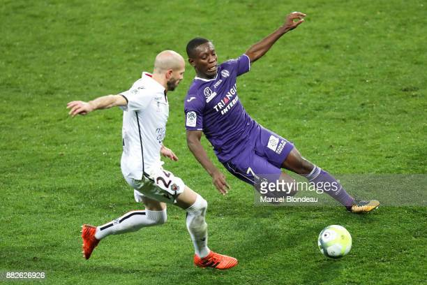 Christophe Jallet of Nice and Max Alain Gradel of Toulouse during the Ligue 1 match between Toulouse and OGC Nice at Stadium Municipal on November 29...