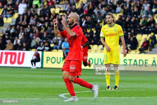 Christophe Jallet of Nice celebrates after scoring a goal during the Ligue 1 match between Nantes and Nice at Stade de la Beaujoire on September 25...