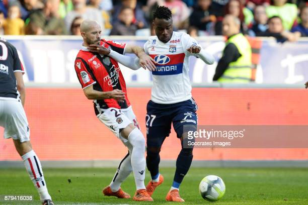 Christophe Jallet of Nice Maxwel Cornet of Olympique Lyon during the French League 1 match between Nice v Olympique Lyon at the Allianz Riviera on...