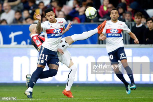 Christophe Jallet of Nice Memphis Depay of Olympique Lyon during the French League 1 match between Nice v Olympique Lyon at the Allianz Riviera on...
