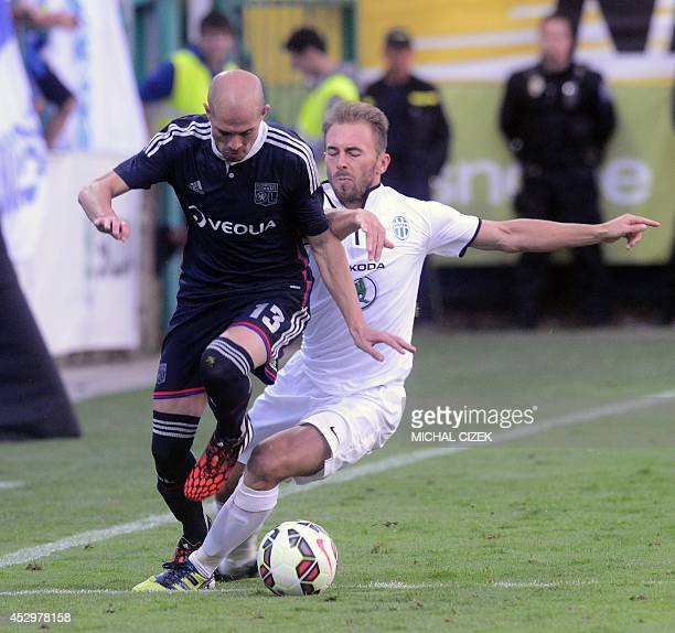 Christophe Jallet of Olympique Lyon fights for a ball with Jan Stonhanzl of FK Mlada Boleslav during the Europa League 3rd qualifying round first leg...