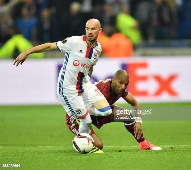 Christophe Jallet of Olympique Lyonnais in action against Ryan Babel of Besiktas during the UEFA Europa League first leg quarter final football match...