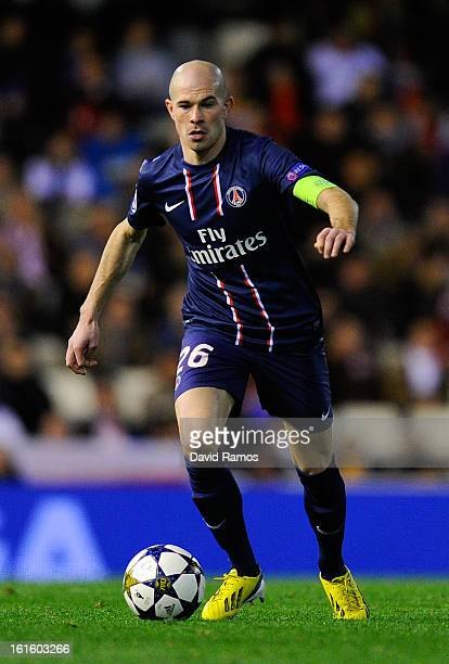 Christophe Jallet of Paris SaintGermain runs with the ball during the UEFA Champions League Round of 16 first leg match between Valencia CF and Paris...