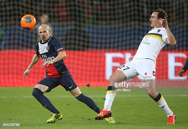 Christophe Jallet of PSG and Loic Poujol of Sochaux in action during the french Ligue 1 match between Paris SaintGermain FC and FC Sochaux...