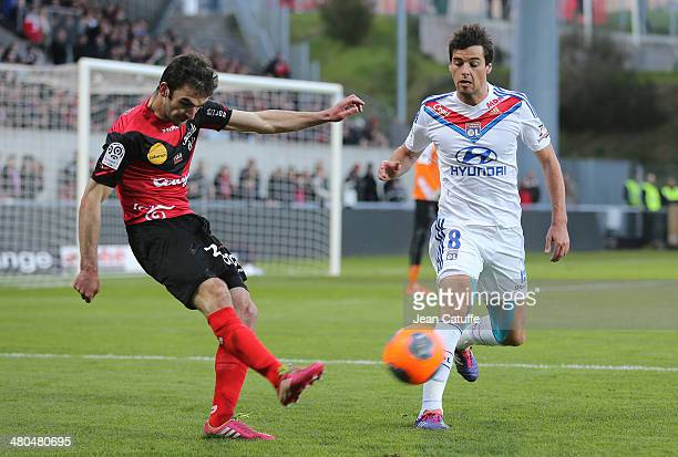 Christophe Kerbrat of Guingamp and Yoann Gourcuff of Lyon in action during the french Ligue 1 match between EA Guingamp FC and Olympique Lyonnais OL...