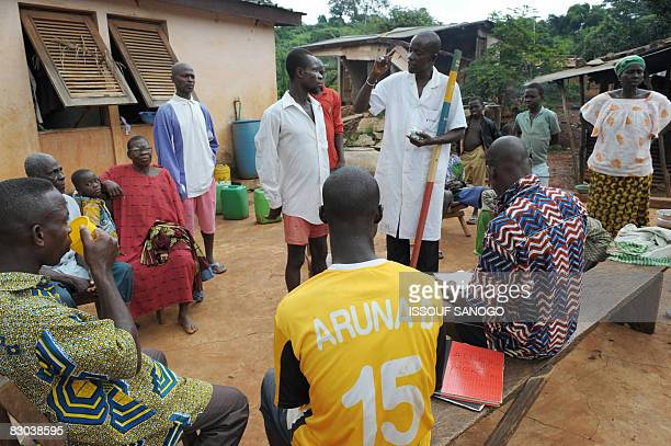 Christophe KOFFI A nurse Mamadou Kone distributes medecine ivermectin against onchocerciasis or river blindness caused by a parasitic worm and spread...